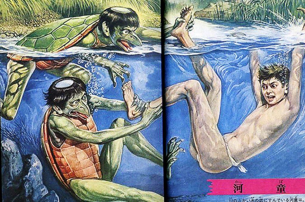 Kappa intenti ad annegare un essere umano